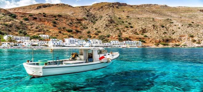 Boat on the sea of Crete beach